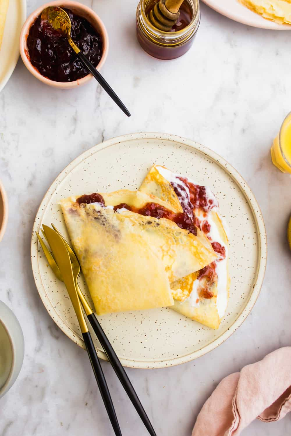 Easy crepes with yogurt and strawberry jam filling.