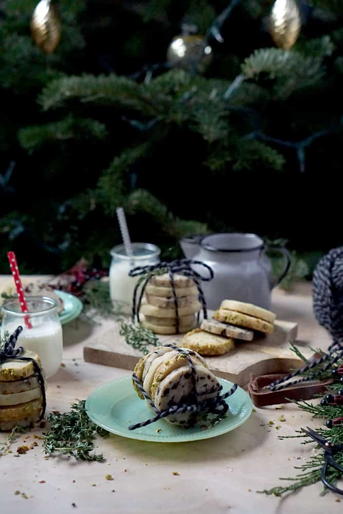 cookies stacked and tied with string on green plate