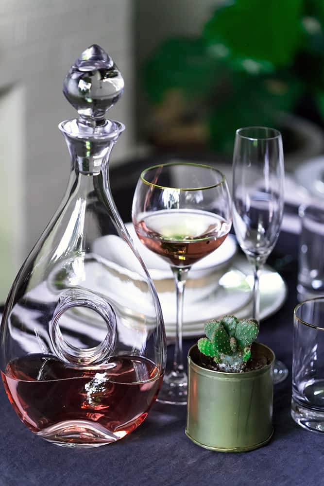 Close up of wine, wine glasses and cactus