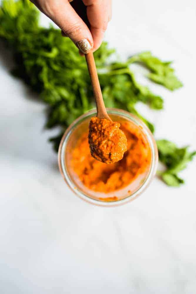 romesco sauce in a jar and spoon