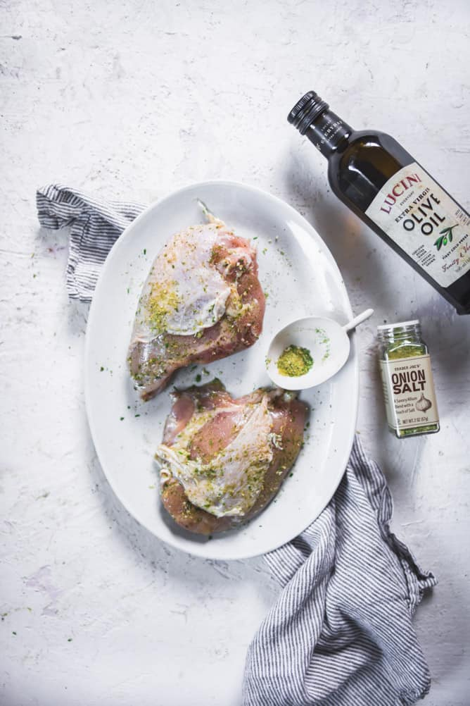 Bone in and skin on everyday baked chicken breast with Lucin olive oil