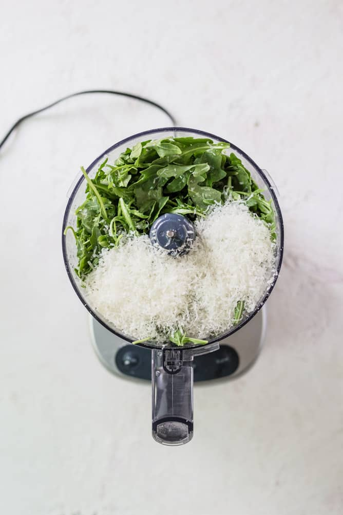 arugula, parmesan cheese in food processor
