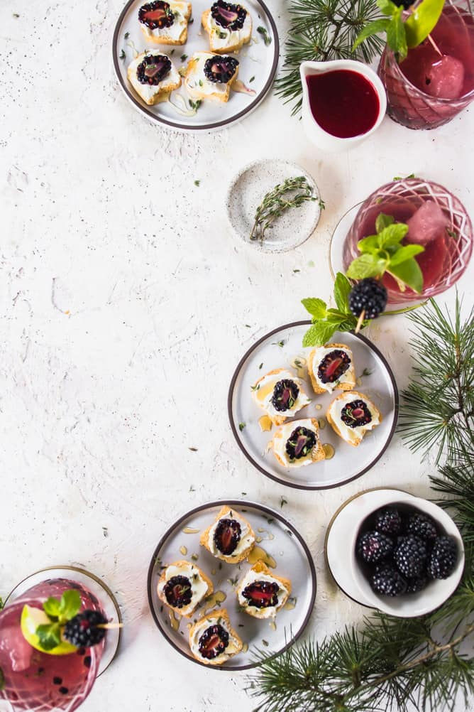 Blackberry Mint Cocktail are refreshing, crisp, tart and sweet. The perfect holiday pairing with Blackberry Goat Cheese Mini Toasts. #drink #cocktails #appetizer #goatcheese #mint