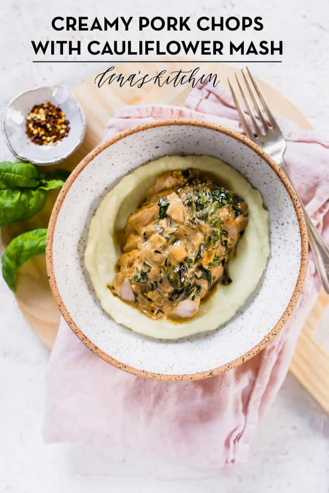 Tender, golden and juicy CREAMY PORK CHOPS WITH CAULIFLOWER MASH. Served in a creamy garlic and spinach sauce filled to the brim with flavour. Low carb, gluten free, easy to make and ready on the table in less than 30 minutes! lenaskitchenblog.com #keto #porkchop #ketomeal #cauliflower