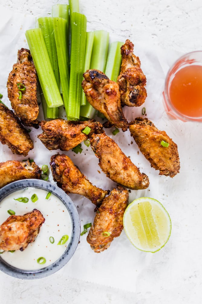 Extra Crispy Air Fryer Wings up close with ranch dressing, lime, and celery. lenaskitchenblog.com