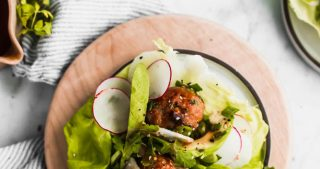 air fryer asian pork meatballs in lettuce cups with fresh vegetables and sesame ginger dressing
