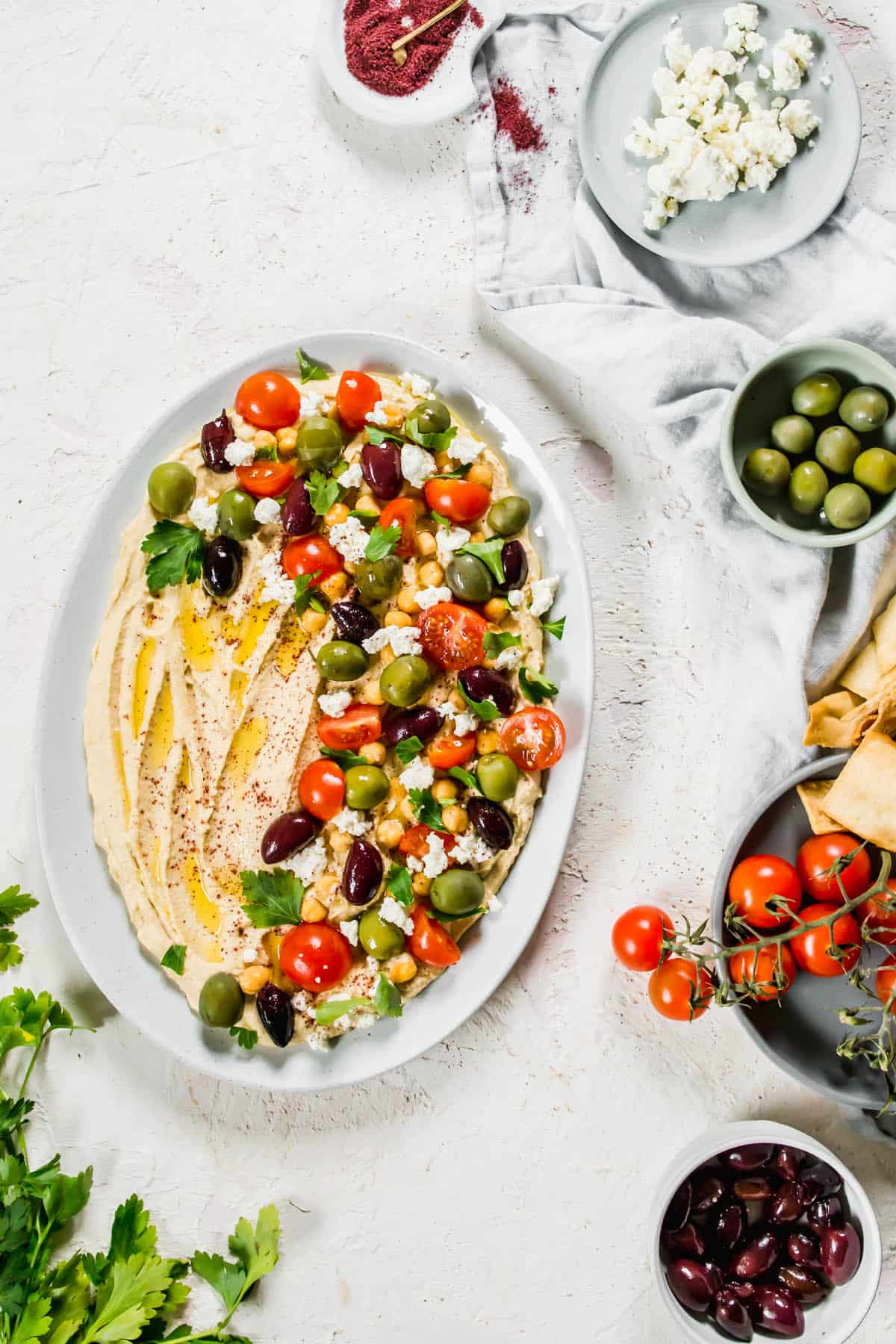 The Best Homemade Loaded Hummus with fresh vegetables and feta