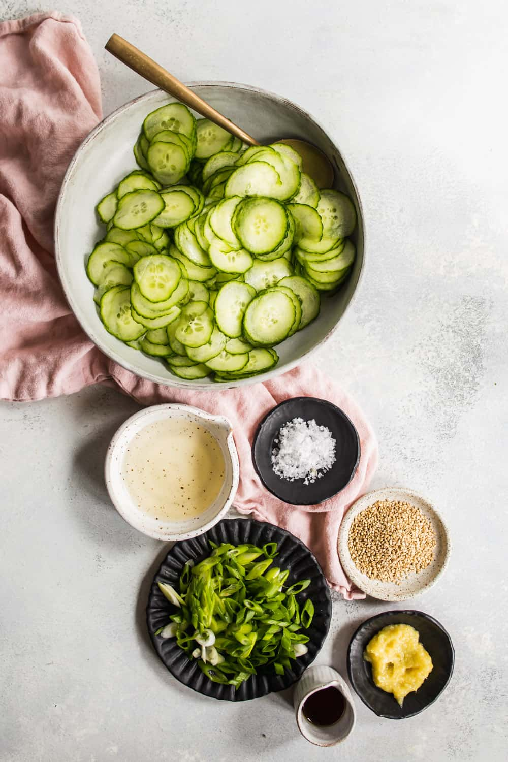 Seperate bowls with asian cucumber salad ingredients