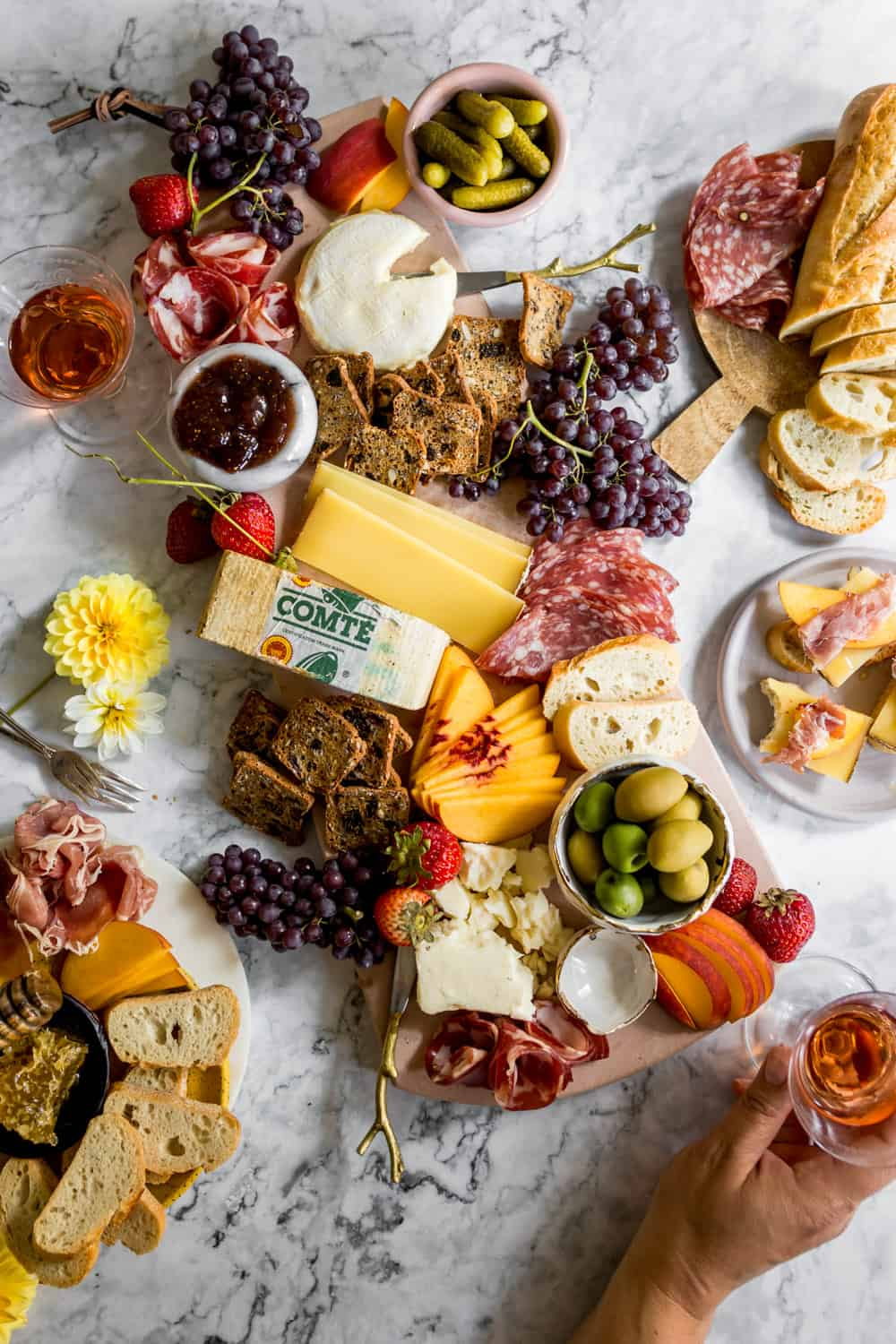 Large platter with cheeses, meats, olives, fruit, and dips.