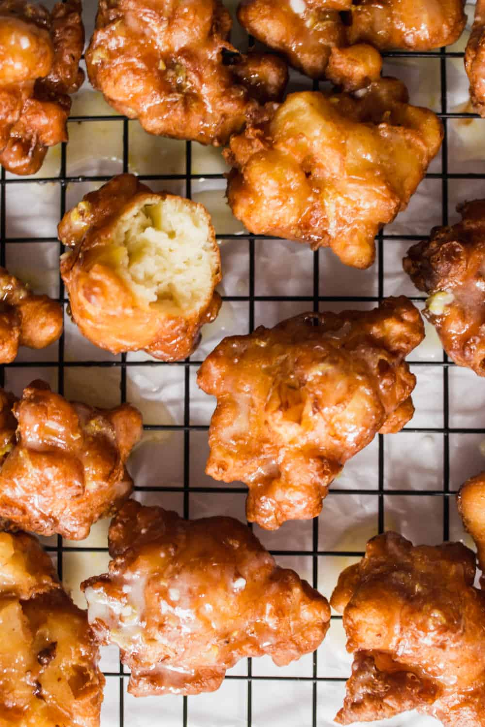 Close up of apple fritters cooling on a cooling rack