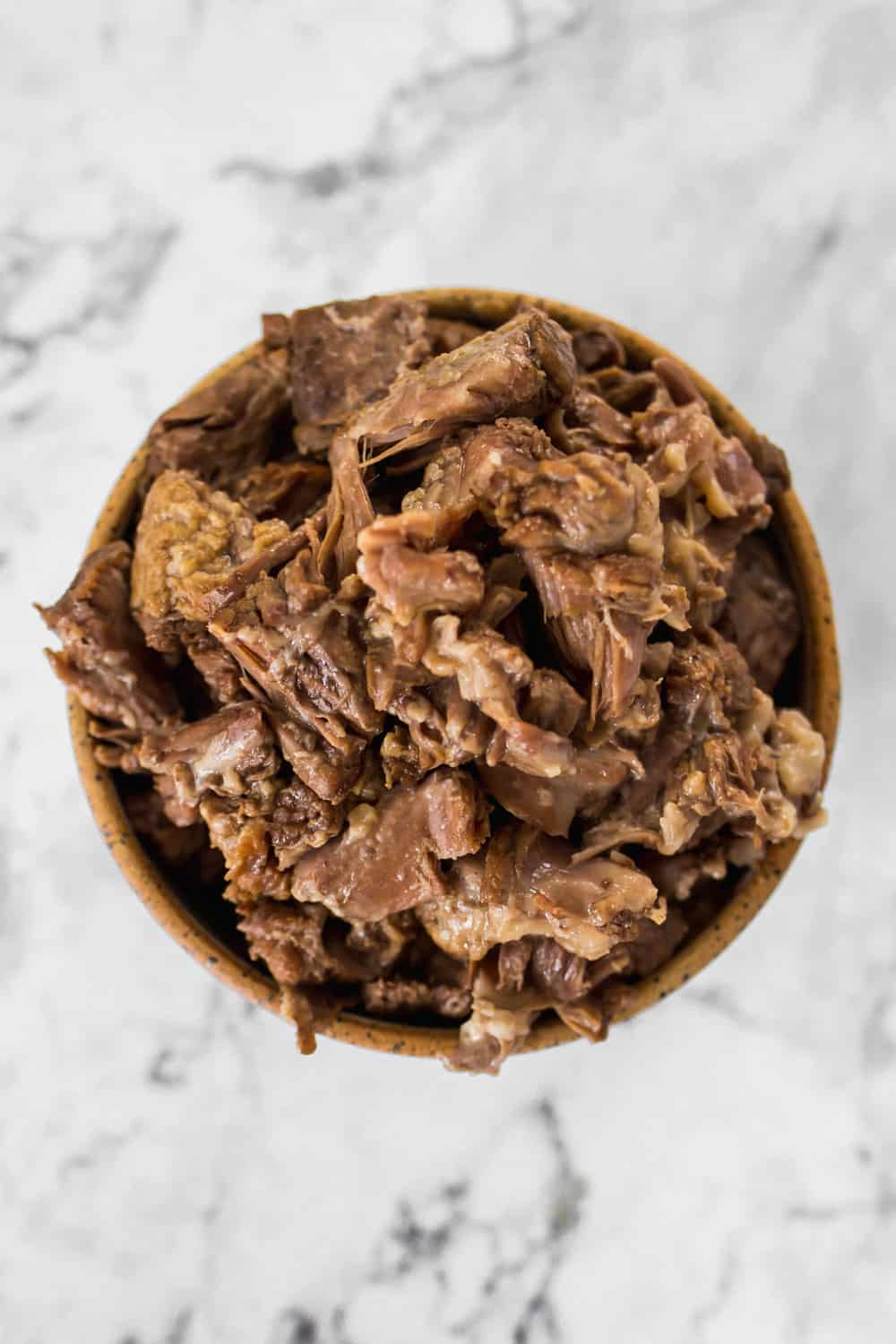 Closeup of a bowl of cooked beef.