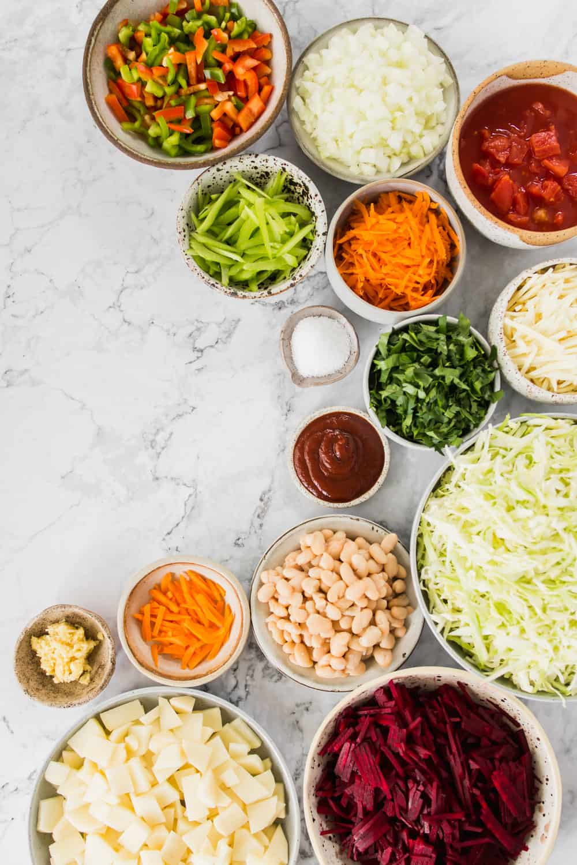 Various soup ingredients in individual bowls