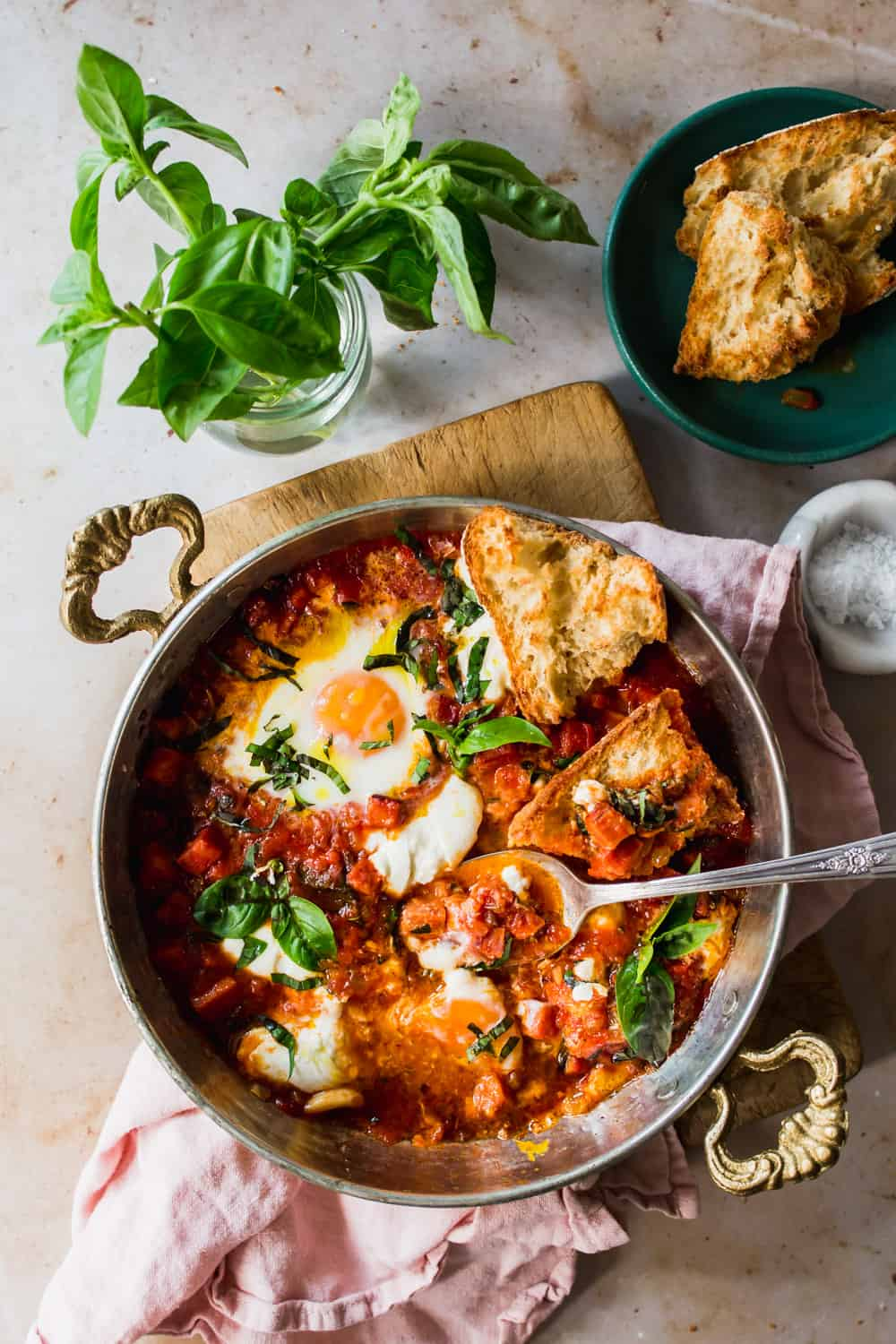 Overhead shot of baked eggs and tomato sauce in a skillet