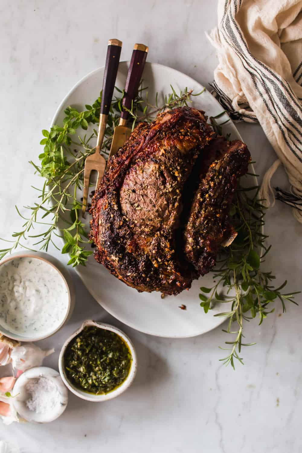 Large beef roast on a white serving plate