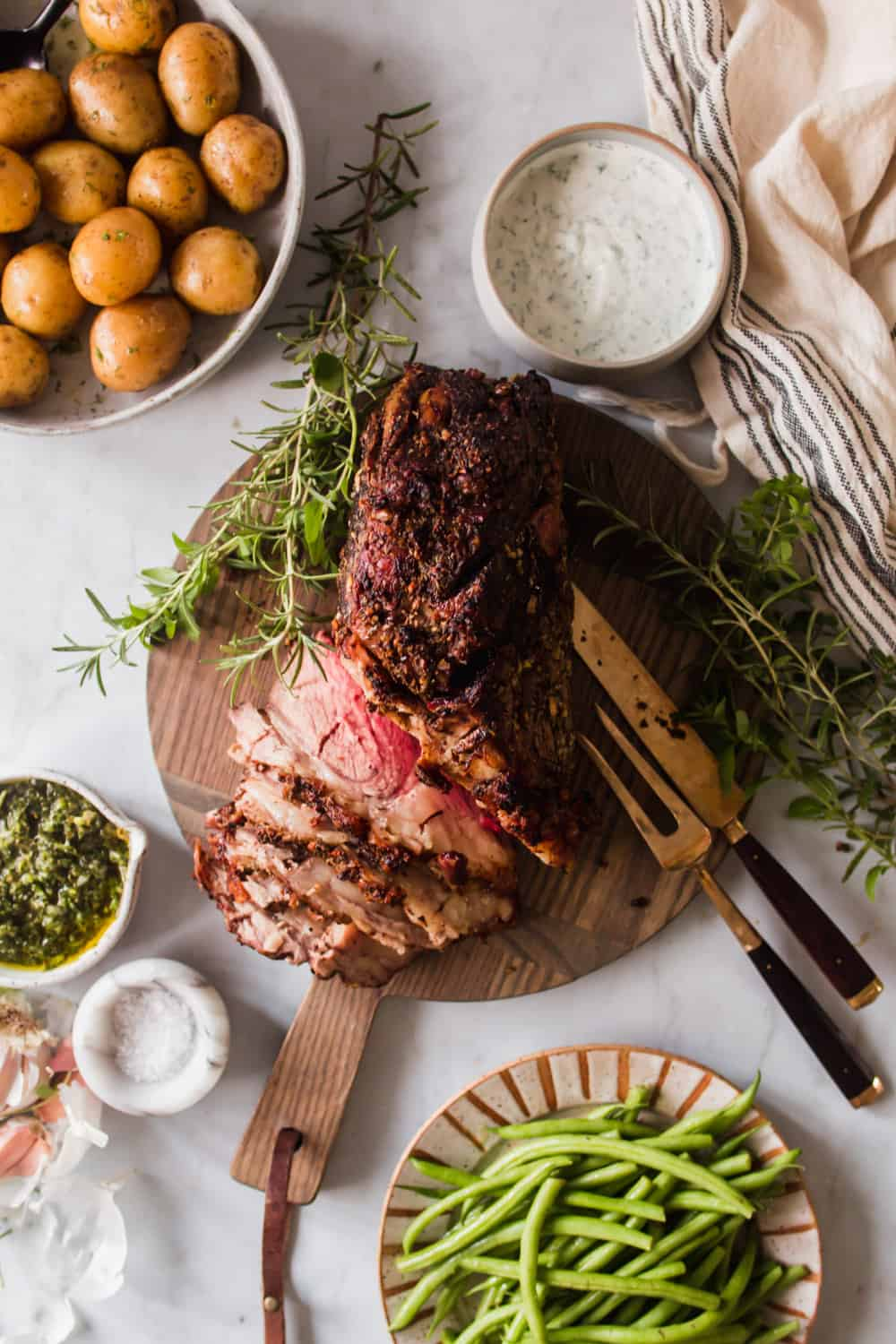 Large sliced beef roast on a wood cutting board