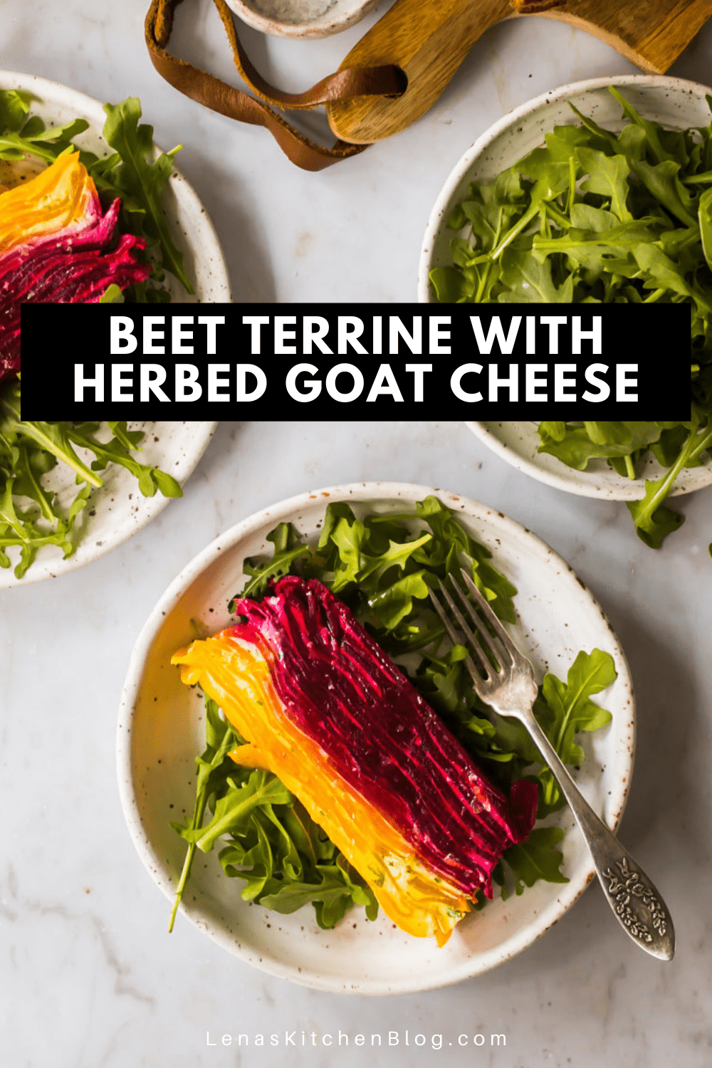 A slice of red and yellow beet terrine on top of arugula