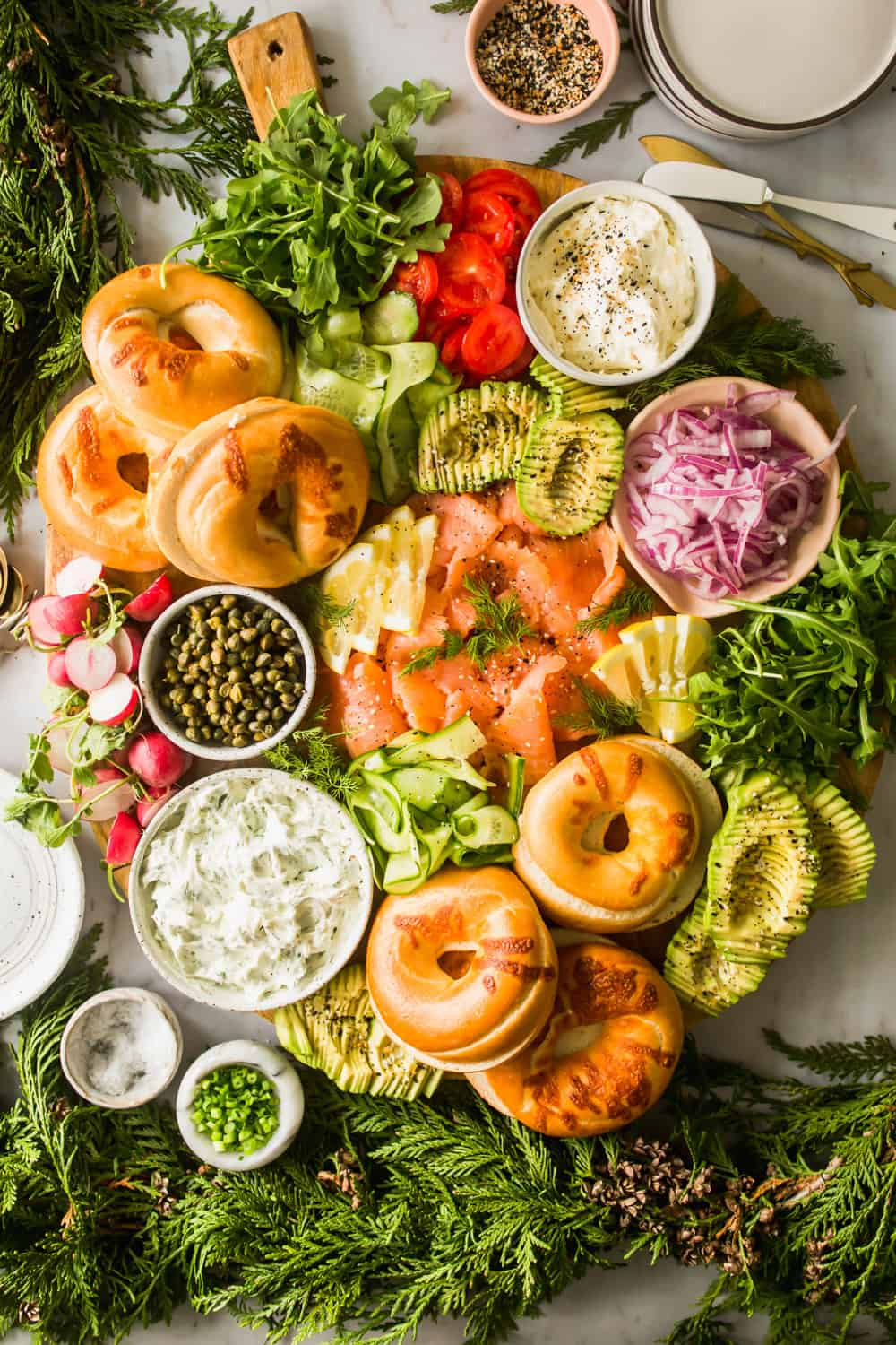 Large platter with bagels, lox, vegetables, and cream cheese