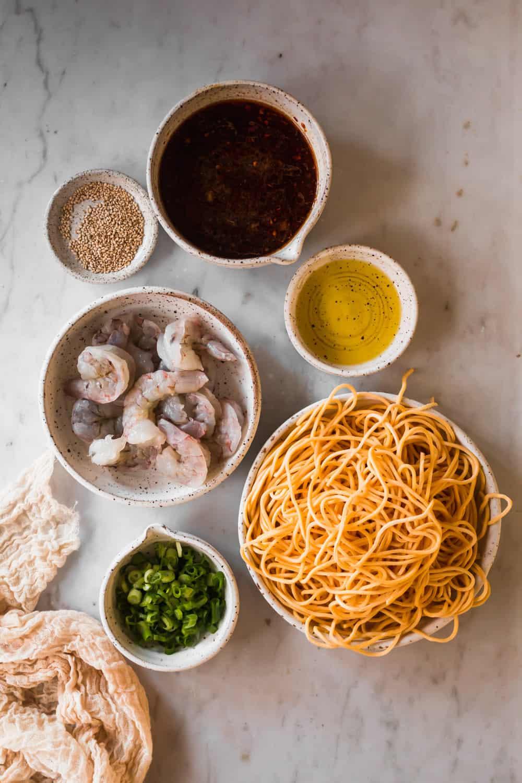 6 white bowls holding shrimp lo mein ingredients