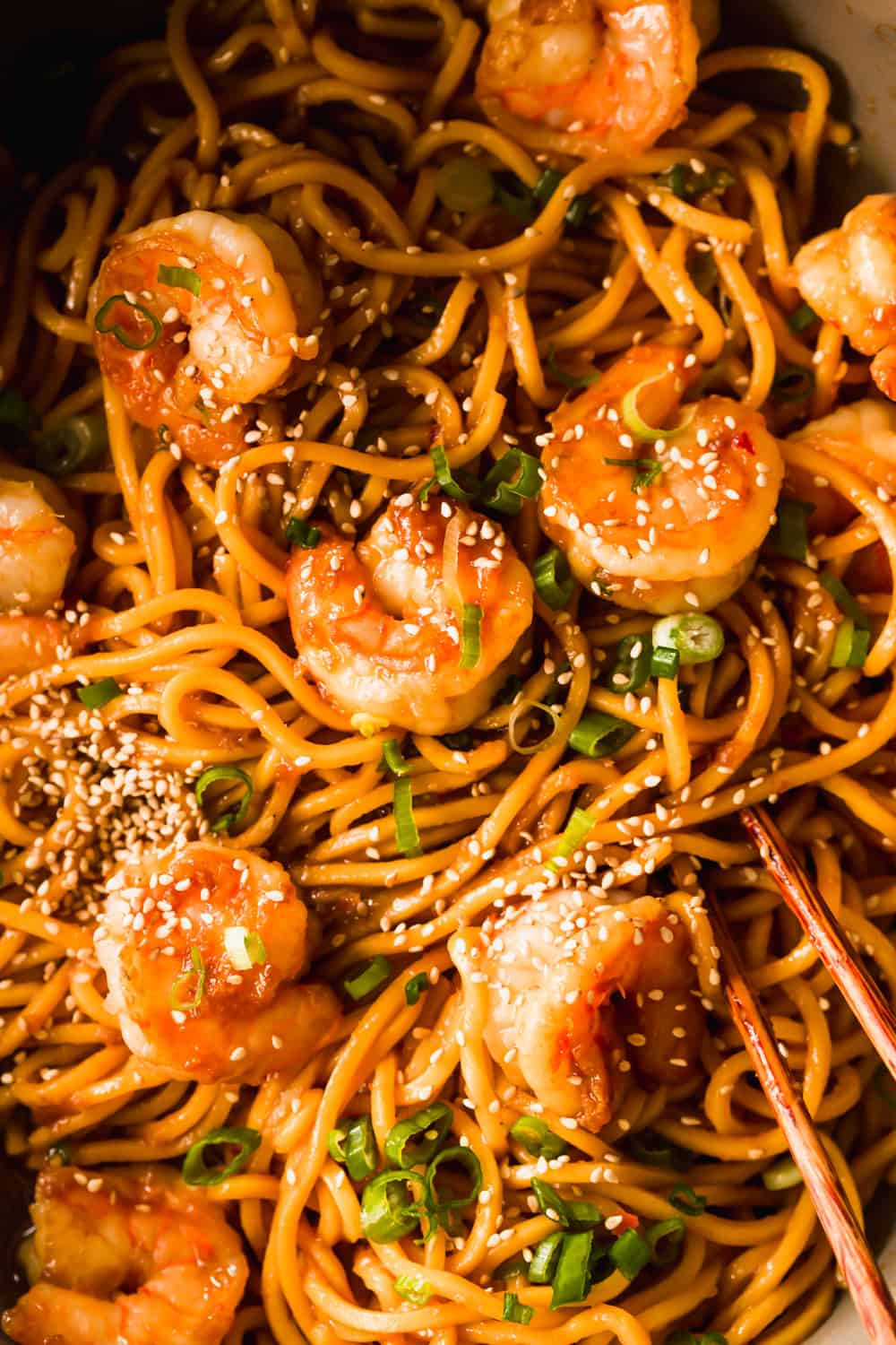 Closeup of noodles and shrimp with sesame seeds on top