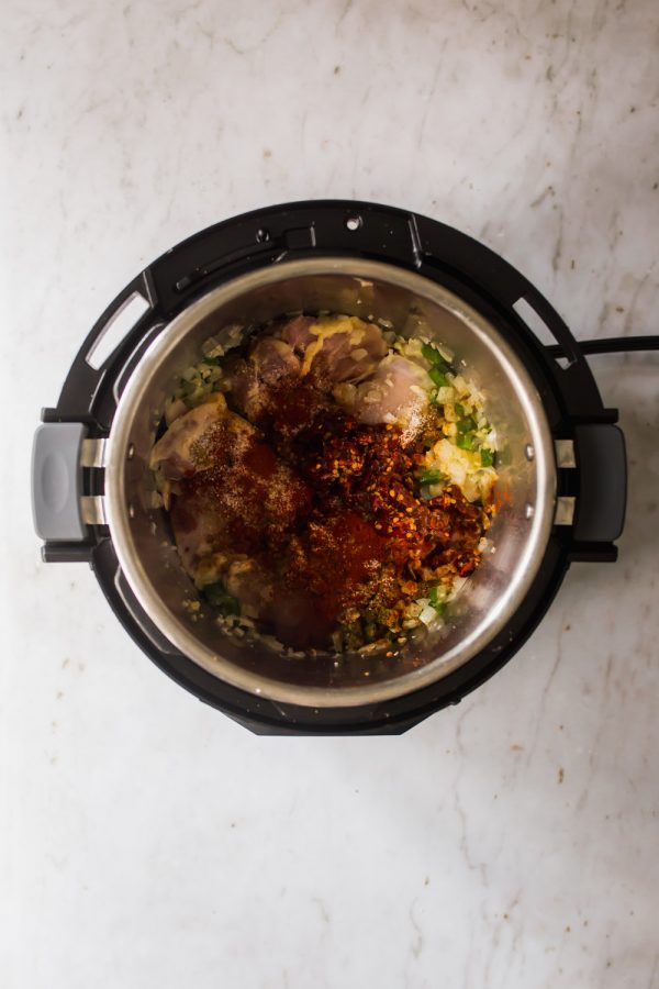 Raw chicken and soup ingredients in an Instant Pot