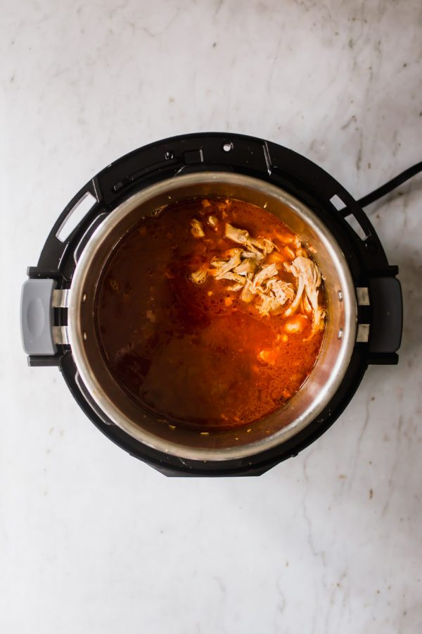 Chicken covered in tomato sauce in an Instant Pot