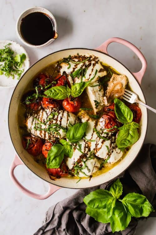 overhead view of caprese chicken pot with fresh basil in a pot
