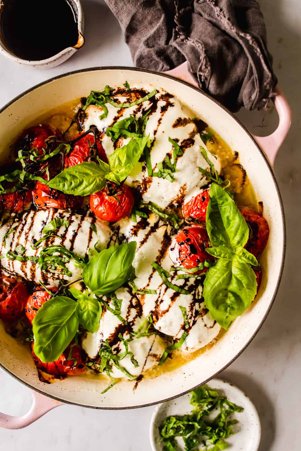 large pot with baked chicken, mozzarella, and tomatoes