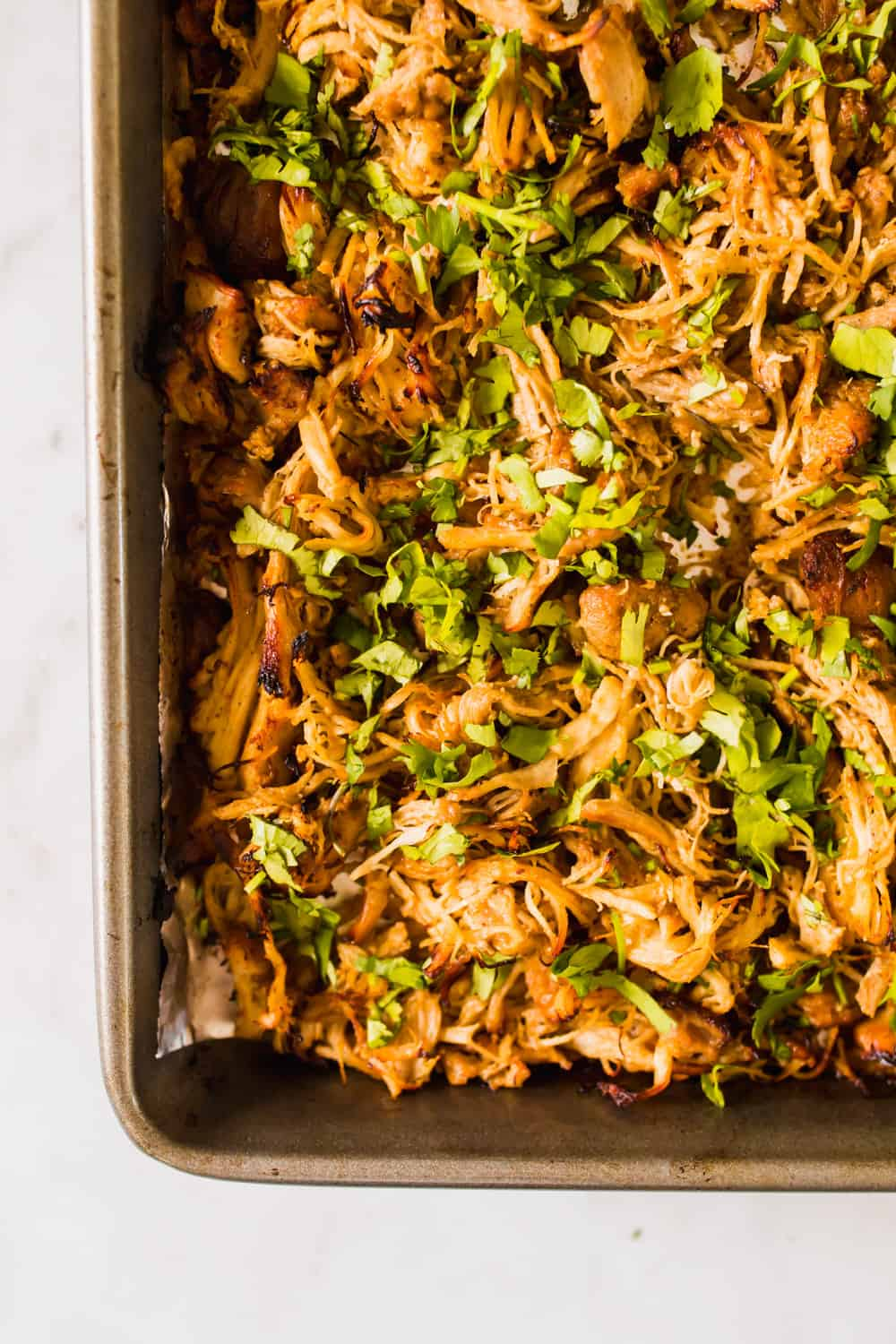 baking sheet filled with browned shredded chicken