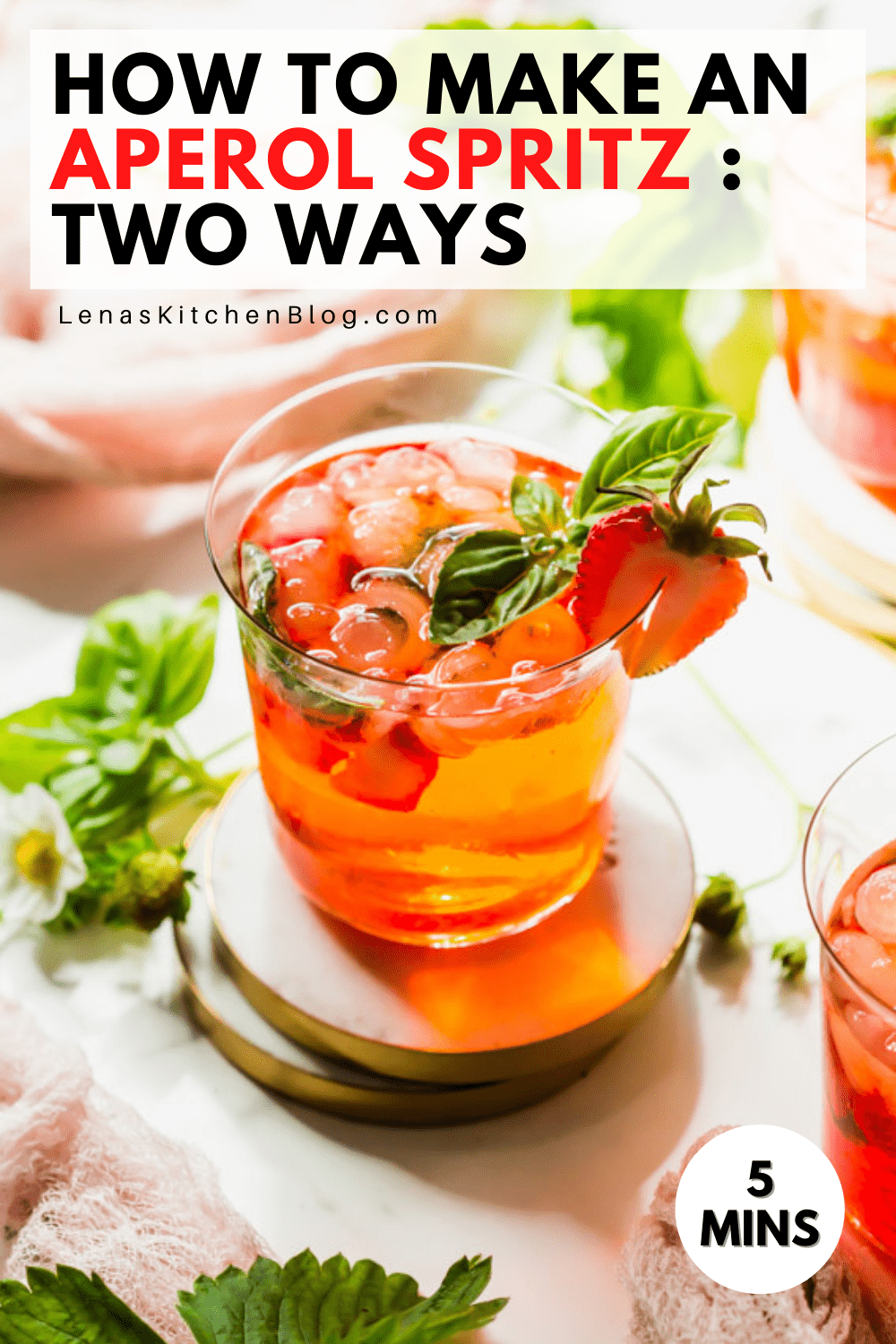 pinterest image of a red drink with strawberries and basil
