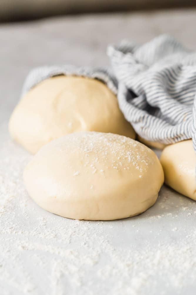 close up of balls of raw bread dough
