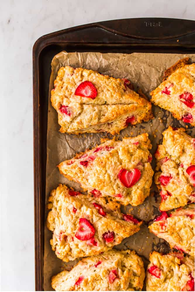 close up on baked strawberry scones on a baking sheet