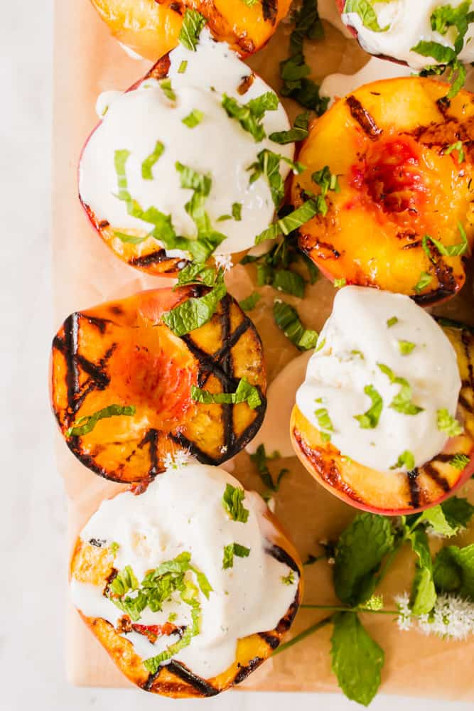 close up on grilled peaches and vanilla ice cream