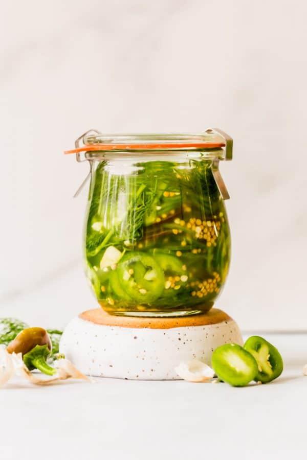 sliced jalapenos in brine in a jar.