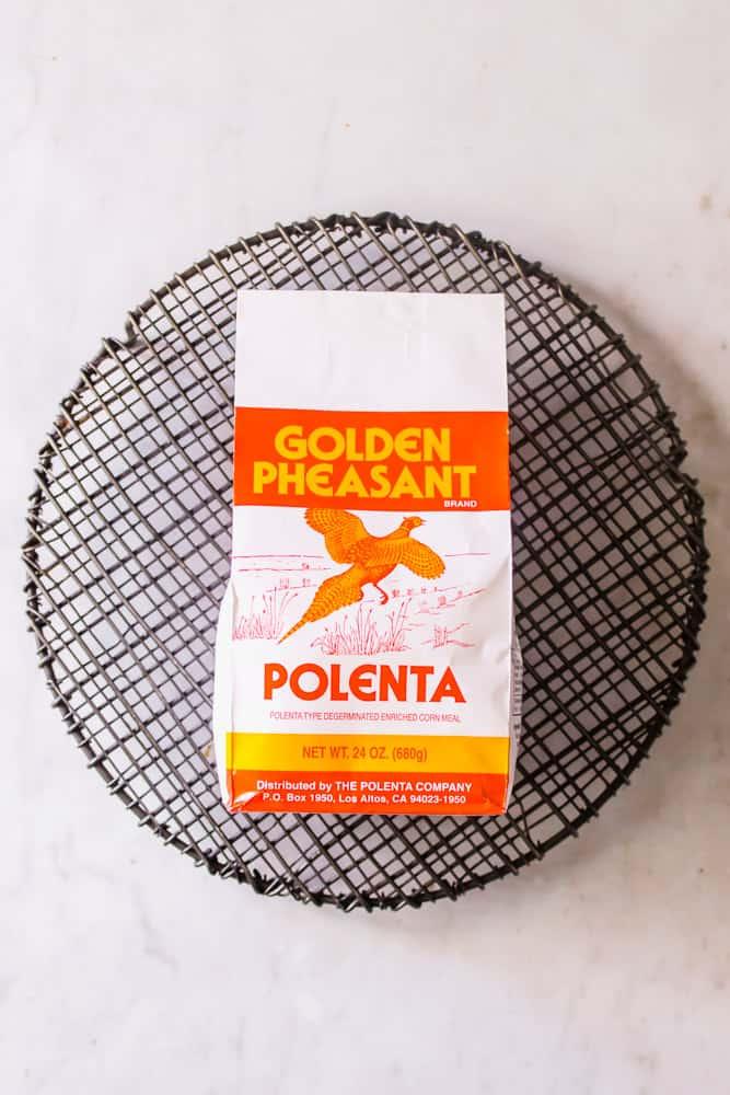 a bag of polenta on a black wire rack.