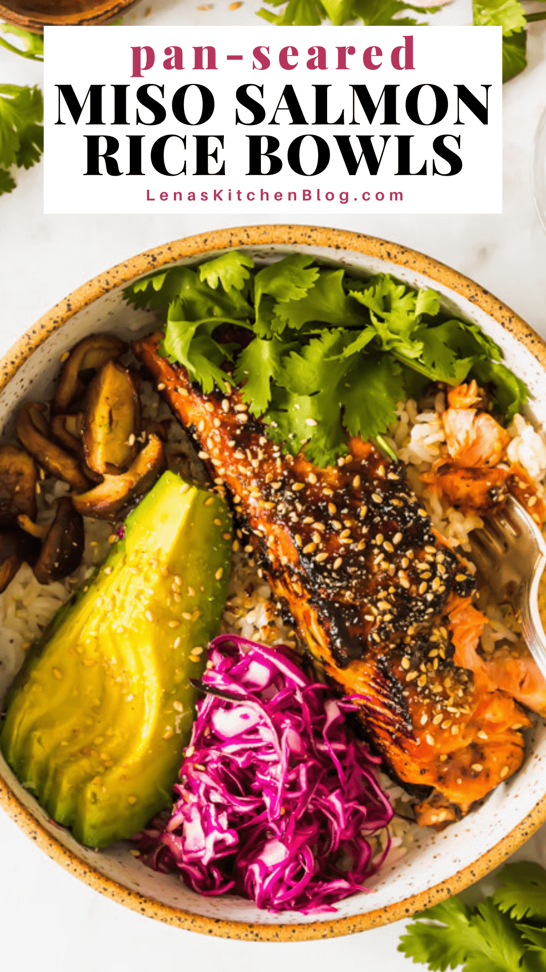 pinterest image of cooked salmon filet in a white bowl with rice, avocado, purple cabbage, mushrooms, and green cilantro.